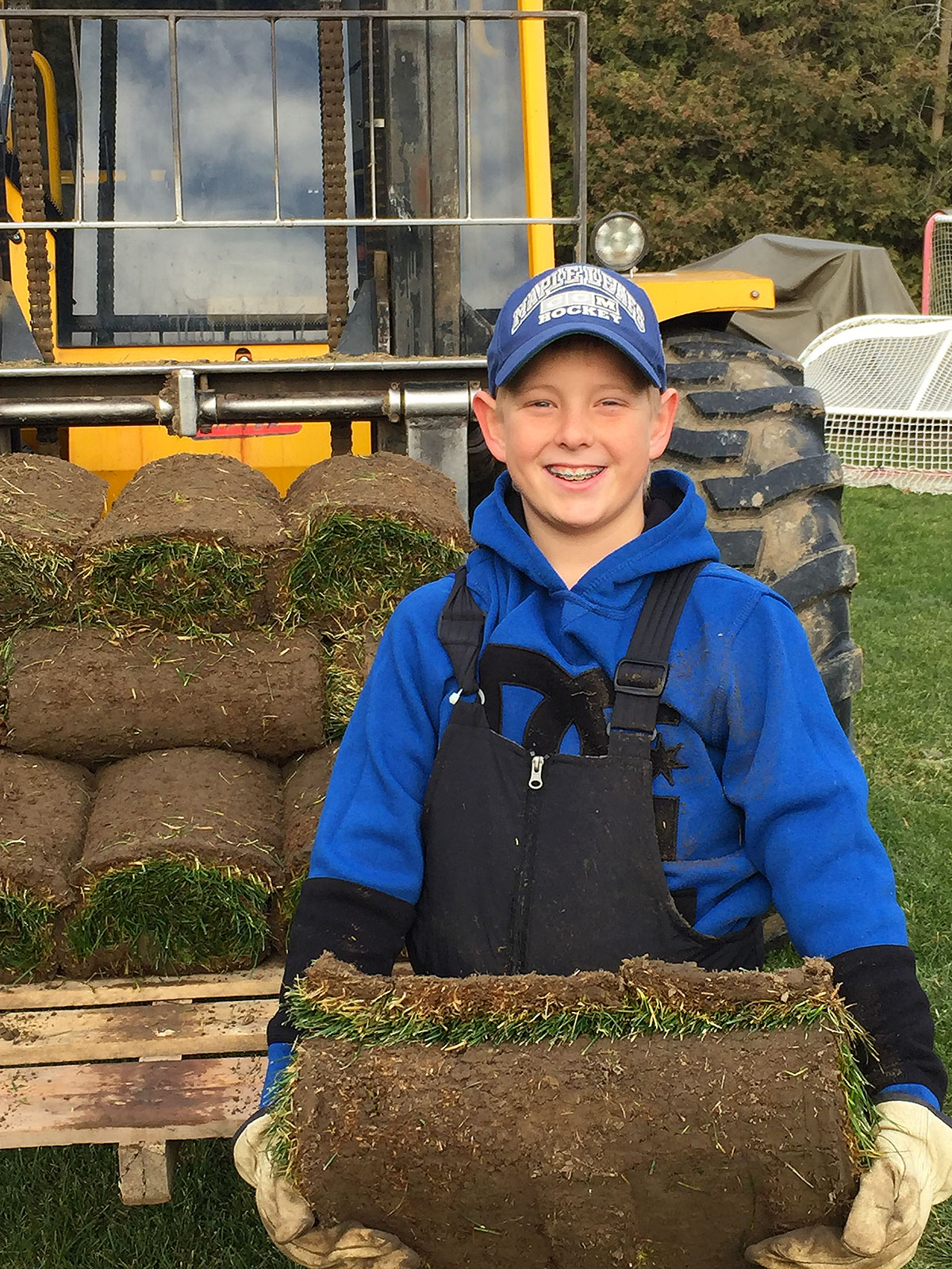 young boy holding sod